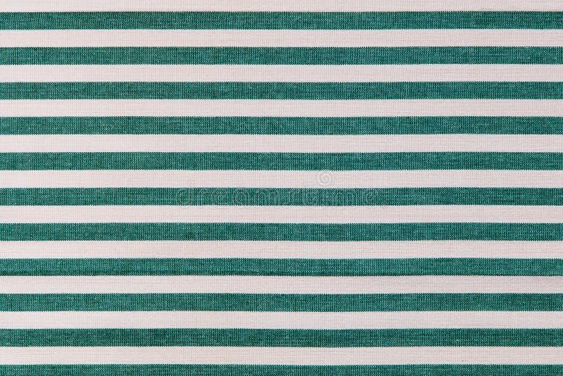 Verde e bianco barra il fondo del tessuto, textur dell'asciugamano di cucina fotografia stock libera da diritti