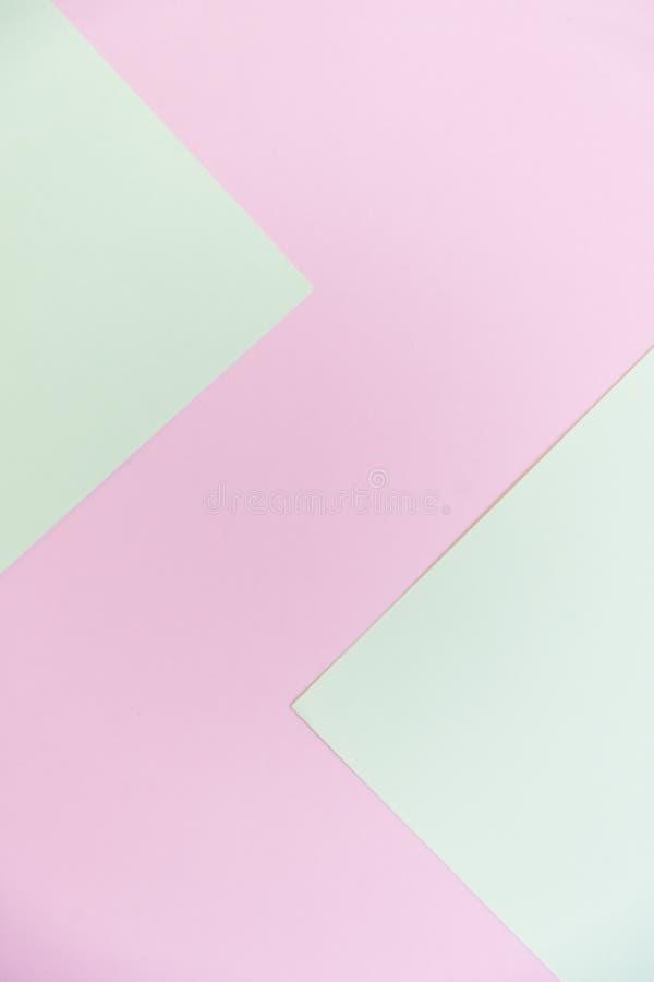 Verde pastel abstrato e fundo colocado liso geométrico do papel cor-de-rosa da cor pastel fotos de stock