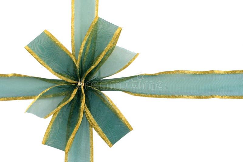 Verde y arqueamiento del regalo del oro fotografía de archivo libre de regalías