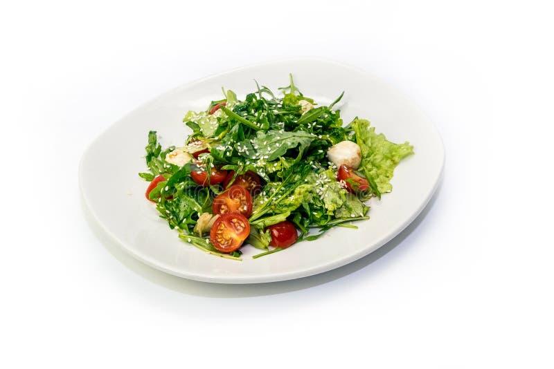 Verdes de la ensalada y tomates de cereza fotos de archivo