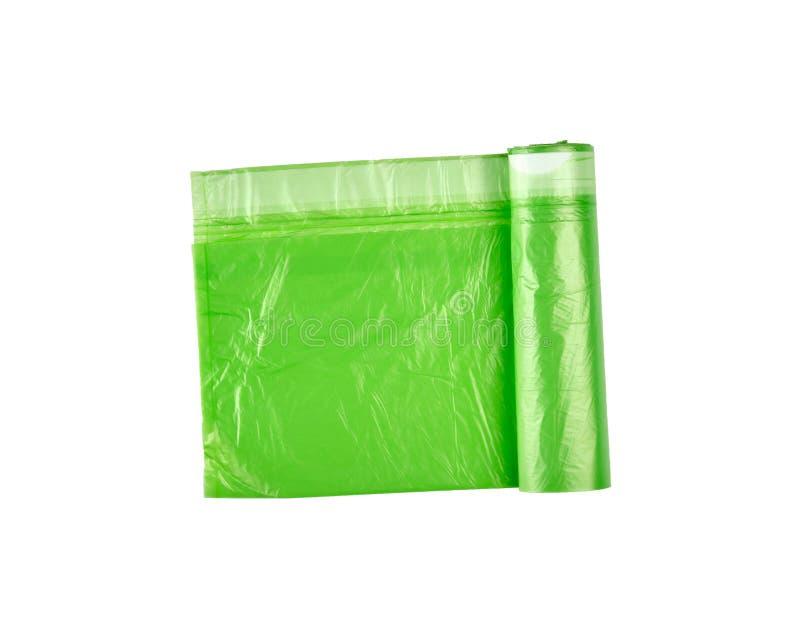 verdrehte grüne Plastiktaschen für Behälter stockbild