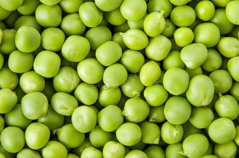 Verdura de la textura del fondo del guisante verde, opinión superior del grano crudo fresco de los guisantes imagen de archivo