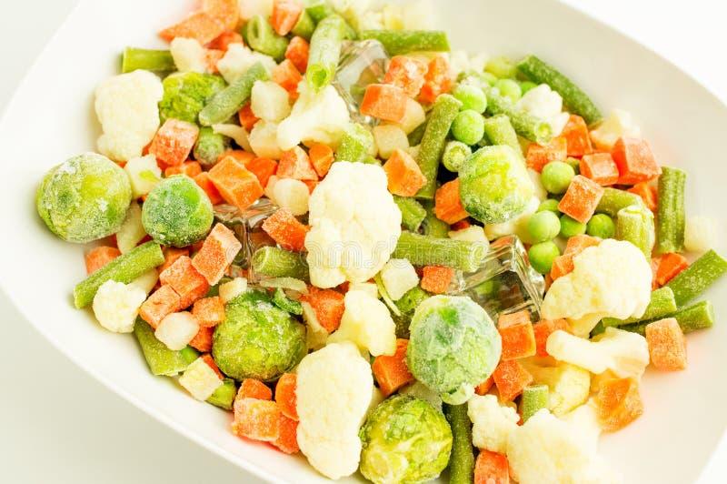 Verduras congeladas fotos de archivo