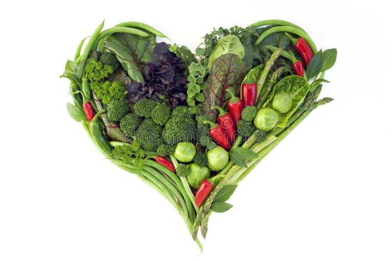 Verduras en la forma de un corazón en un fondo blanco foto de archivo libre de regalías