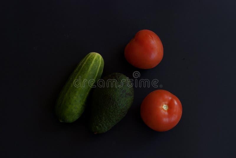 Verduras frescas en el fondo negro foto de archivo libre de regalías