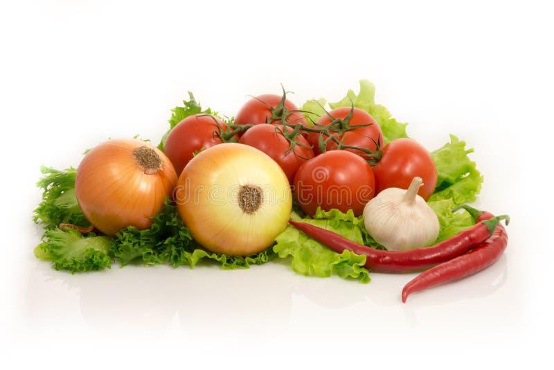 Verduras - lechuga, cebolla, ajo, pimienta de chiles, tomates fotografía de archivo libre de regalías