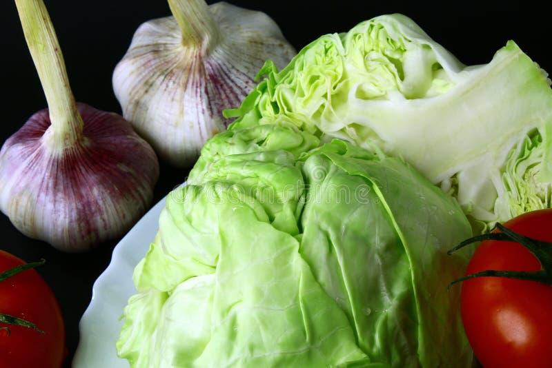 Verduras naturales frescas en fondo negro foto de archivo
