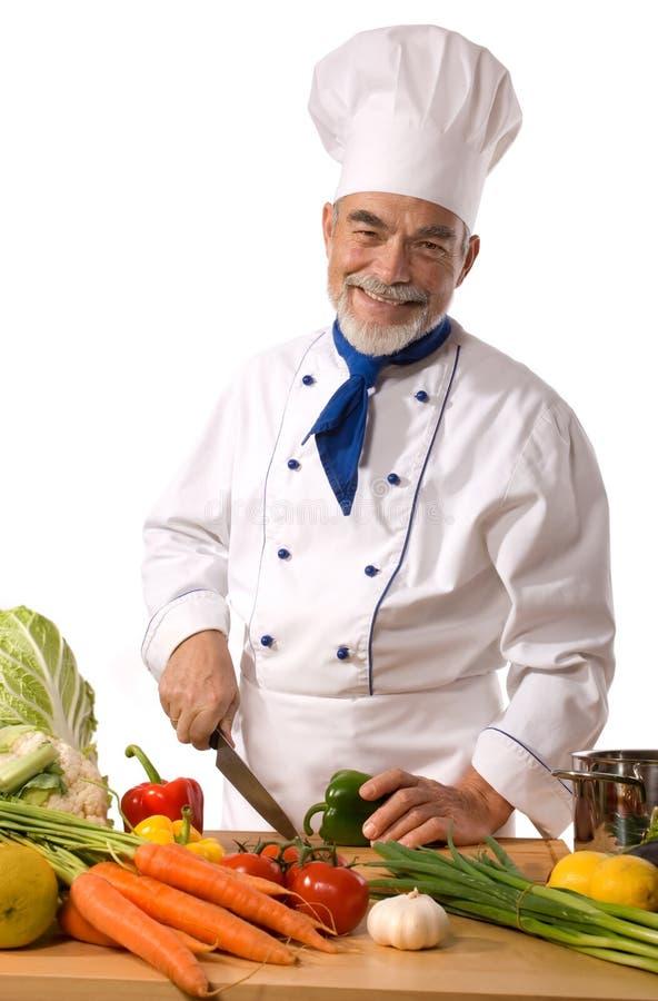 Verdure di taglio del cuoco unico fotografie stock
