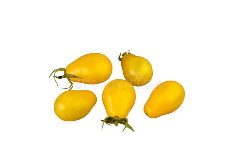 Verdure a forma di pera gialle dei pomodori isolate su fondo bianco fotografie stock