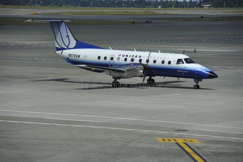 Verenigd Uitdrukkelijk Vliegtuig stock fotografie