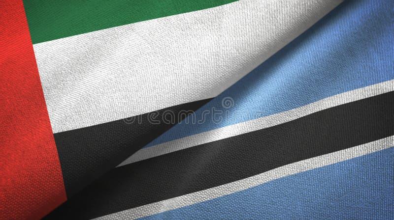 Verenigde Arabische Emiraten en Botswana twee vlaggen textieldoek, stoffentextuur royalty-vrije illustratie