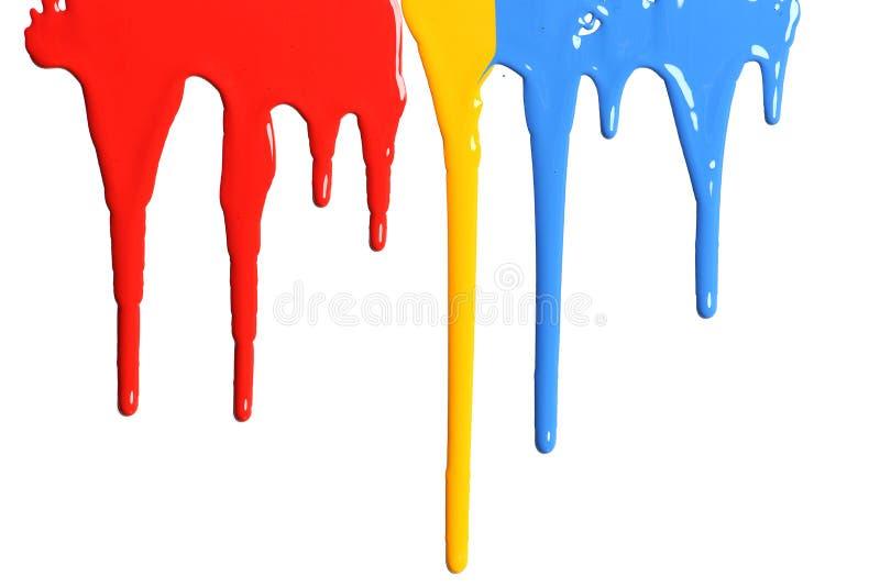Verf die in primaire kleuren druipen stock afbeeldingen