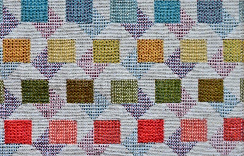 Verf geweven gekleurde textiel als achtergrond stock foto