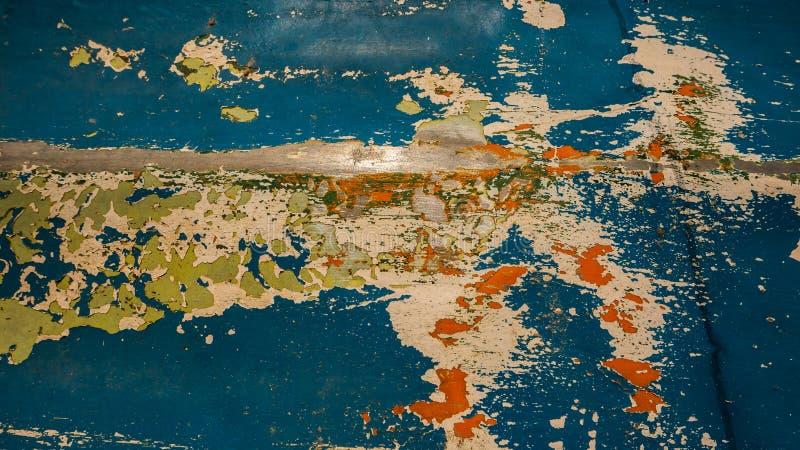 Verf op een een het ontwerpachtergrond en textuur van de ijzermuur royalty-vrije stock afbeeldingen