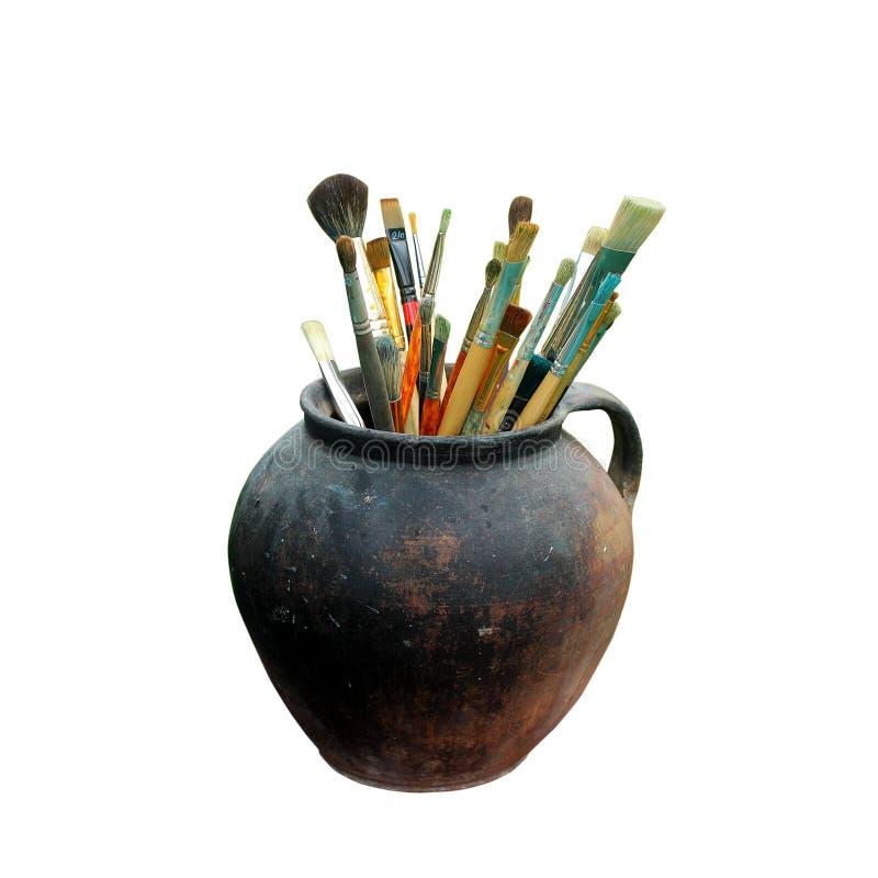 Verfborstels in geïsoleerde pot stock afbeeldingen