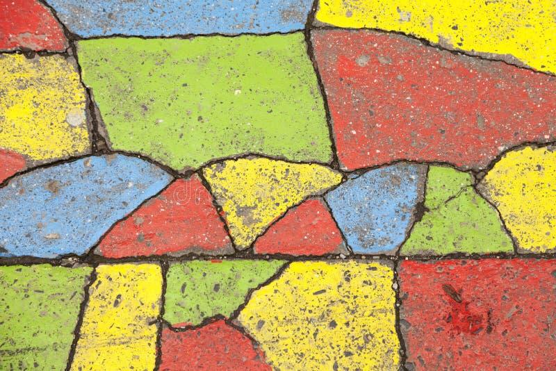 Verfraaid asfalt in verschillende kleuren stock afbeeldingen