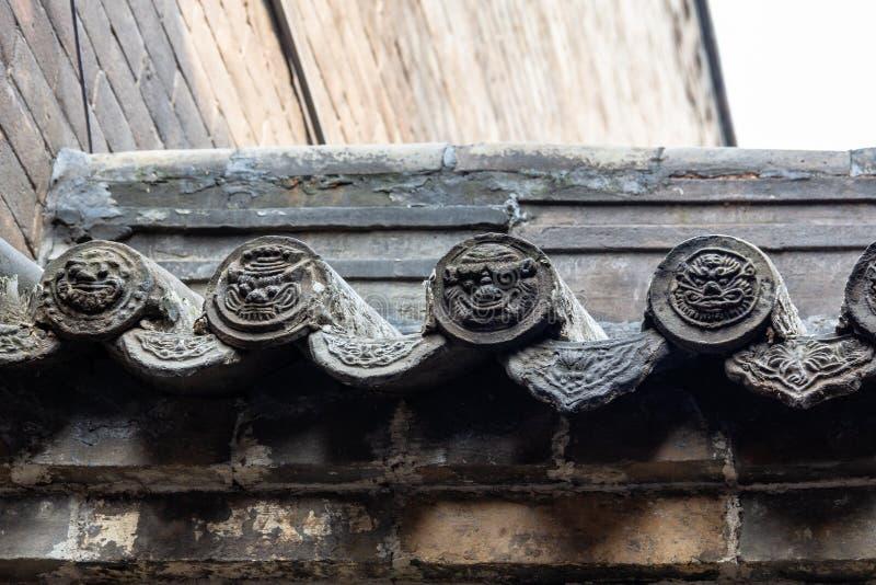 Verfraaide tegels in één van de binnenplaatsen van Ri Sheng Chang, de oudste bank in de wereld in Pingyao royalty-vrije stock fotografie