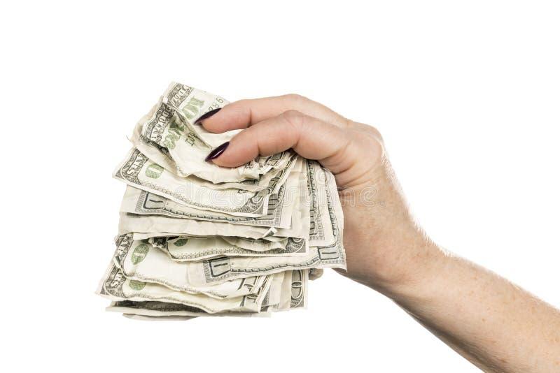 Verfrommeld geld in vrouwelijke hand stock foto's