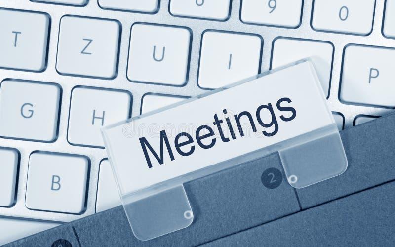 Vergaderingenomslag op computer stock afbeeldingen