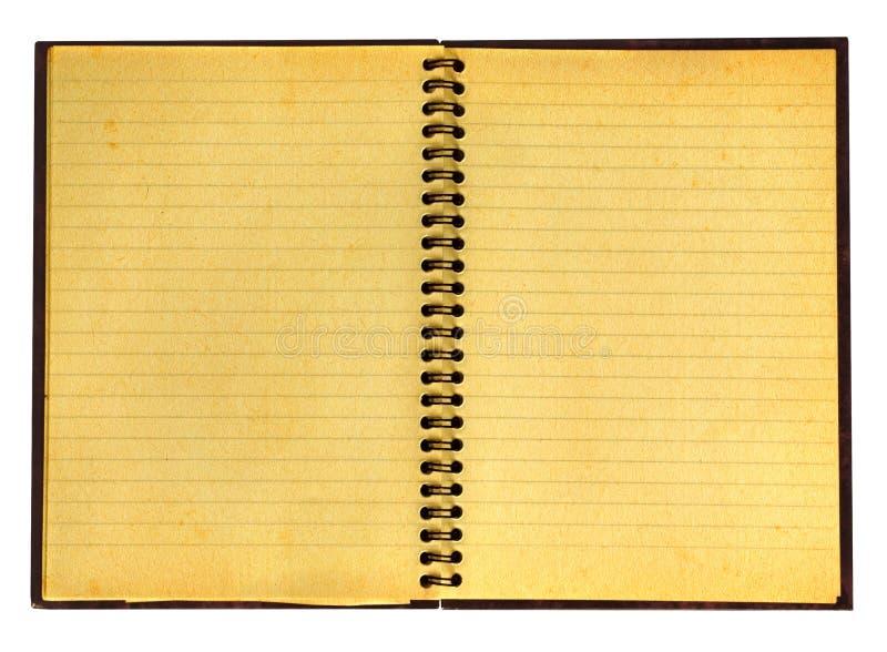 Vergeeld open notitieboekje stock foto's