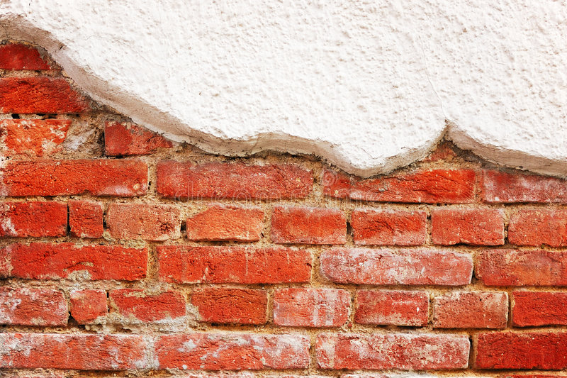 Vergipste Backsteinmauer stockfotos