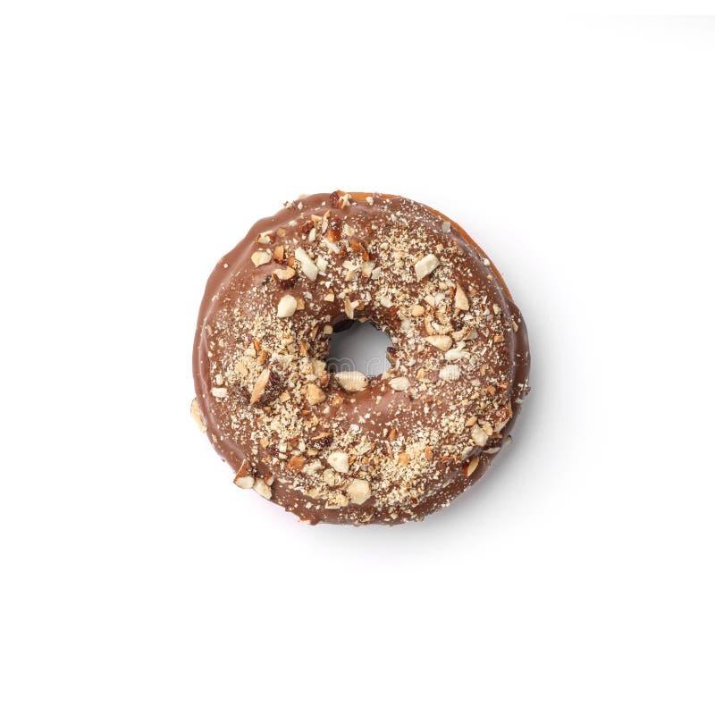 Verglaasde doughnut met melkchocola en notemuskaat Hoogste mening Geïsoleerd beeld stock afbeeldingen