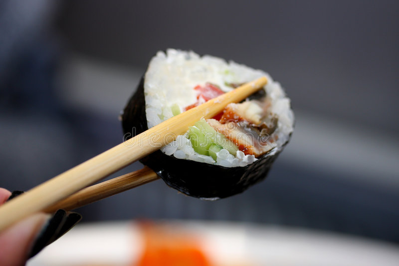 Vergnügen durch Mahlzeit in der japanischen Art lizenzfreie stockfotografie