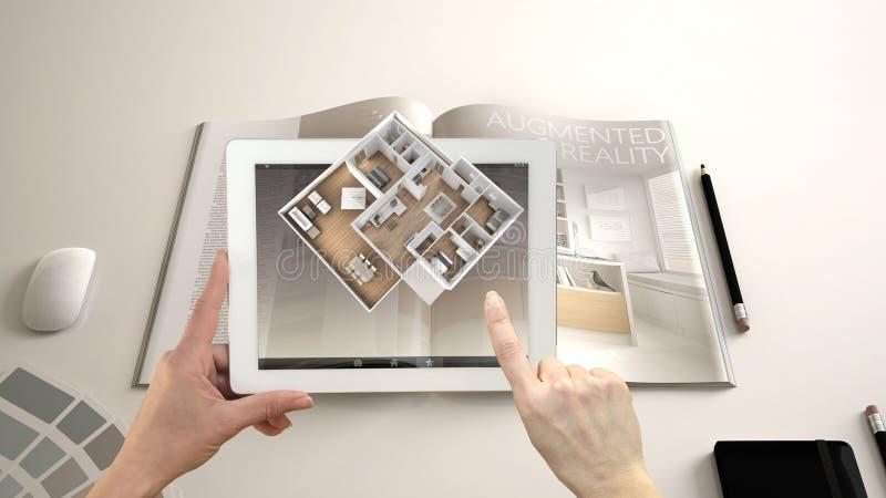 Vergroot werkelijkheidsconcept De tablet van de handholding met de toepassing van AR wordt gebruikt om 3d pop-up interactieve rui stock foto's