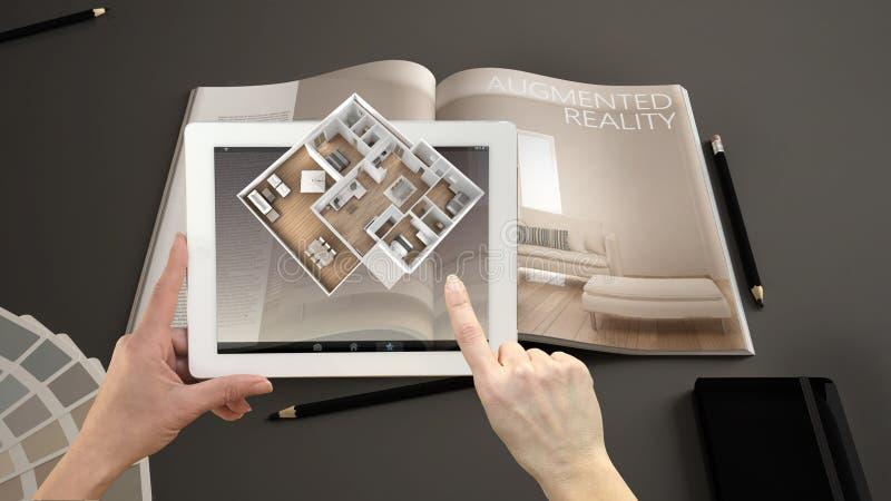 Vergroot werkelijkheidsconcept De tablet van de handholding met de toepassing van AR wordt gebruikt om 3d pop-up interactieve rui stock foto