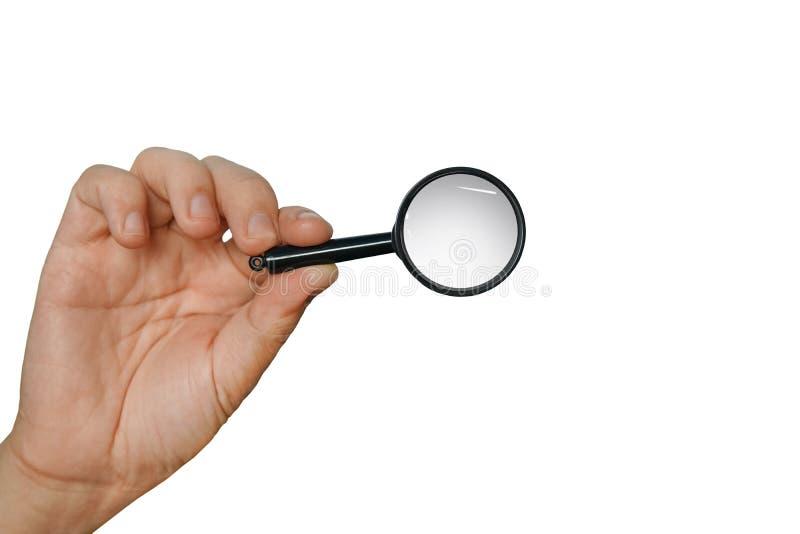 Vergrootglas in een hand op een witte achtergrond wordt geïsoleerd die Concept het zoeken, kijkend door meer magnifier, het onder royalty-vrije stock fotografie