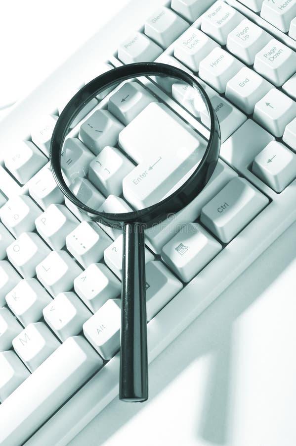 Vergrootglas, knoop, sleutel stock afbeeldingen