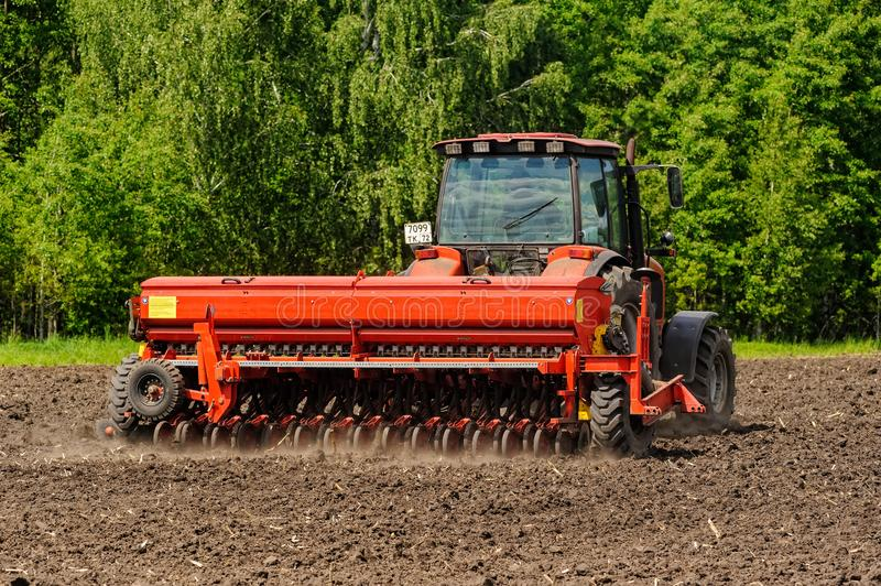 Farmer seeding crops at field royalty free stock photography