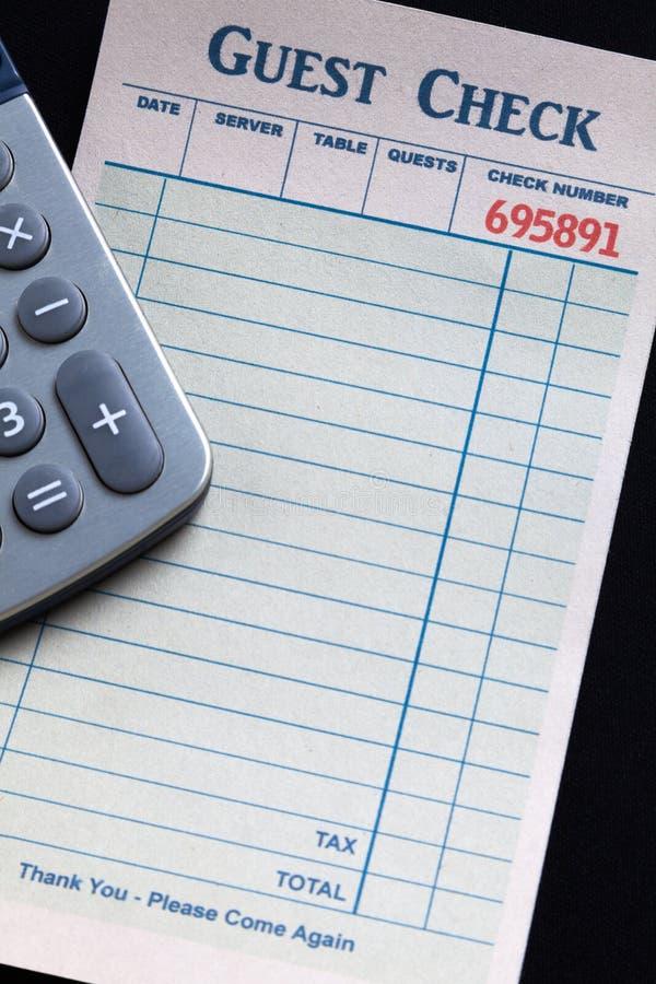 Verificação e calculadora do convidado imagem de stock royalty free