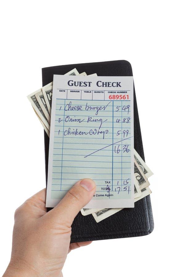 Verificação e dólar do convidado imagem de stock royalty free