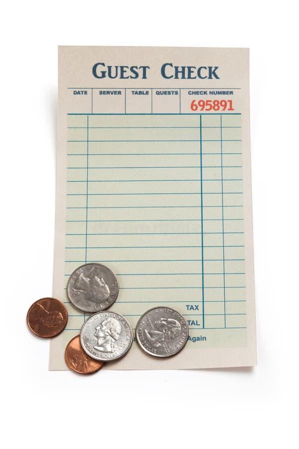Verificação e moeda vazias do convidado fotografia de stock royalty free