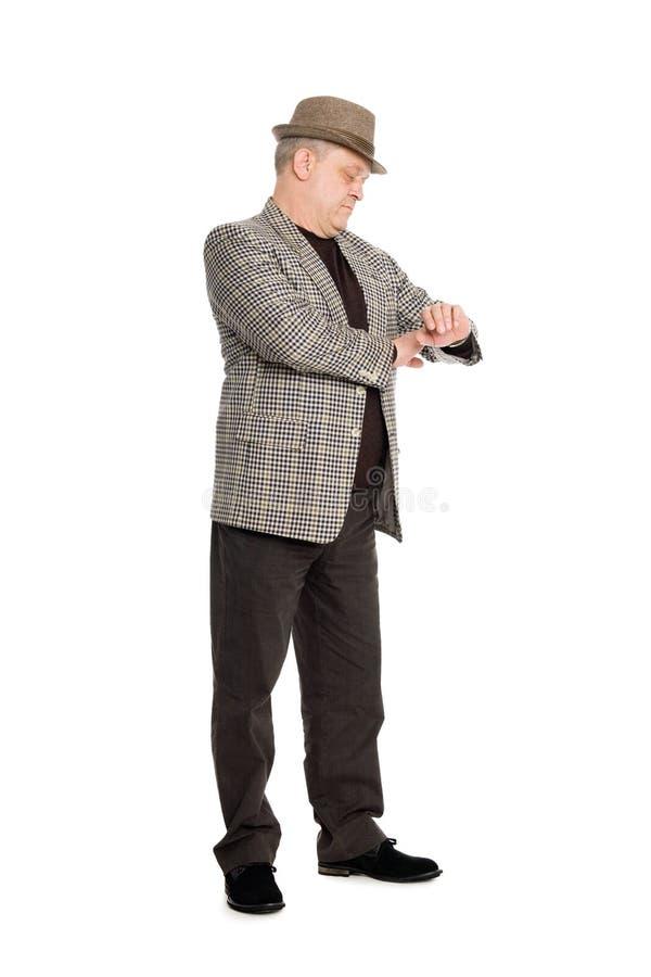 Verificaciones que esperan del hombre para el suyo reloj. fotos de archivo