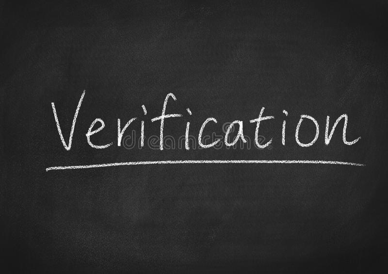 Verification. Concept word on a chalkboard background royalty free stock photo