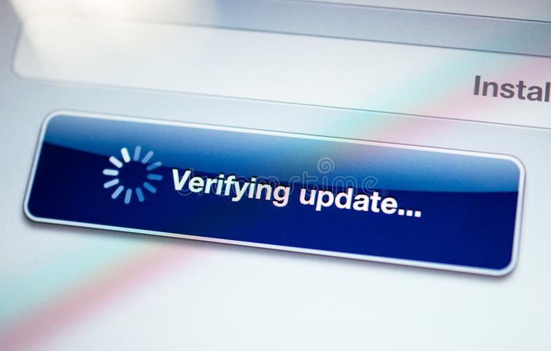 Verifying update message with spinning cursor stock images