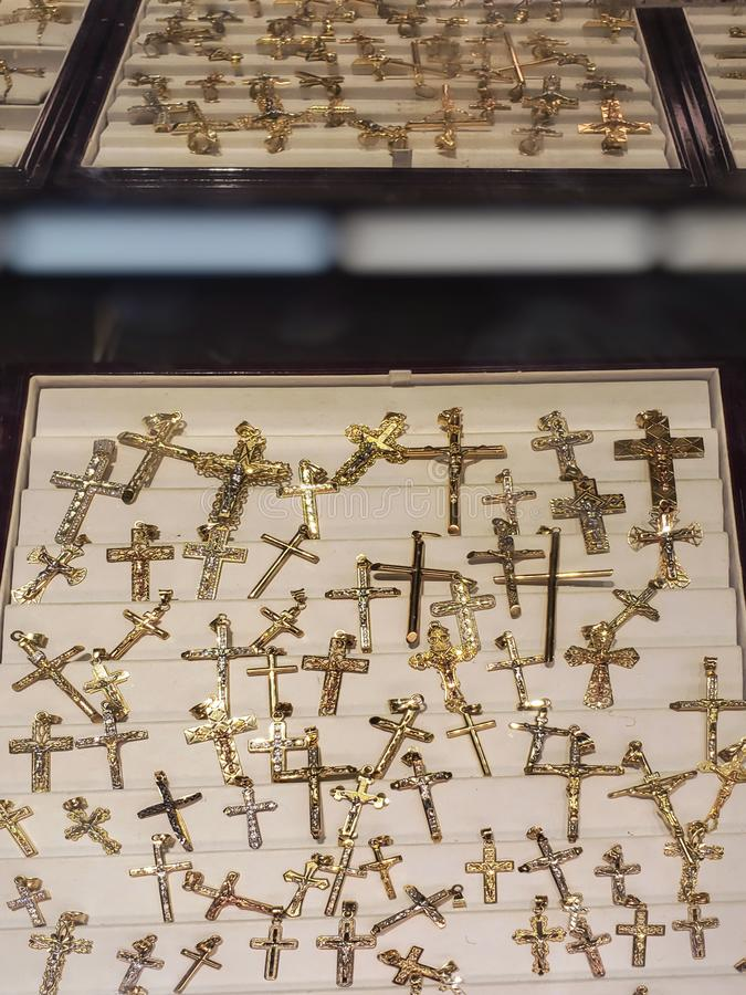Verity of cross chain lockets in a shelve. royalty free stock image