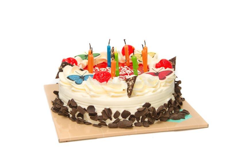 Verjaardagscake met kaarsen op een plaat royalty-vrije stock foto