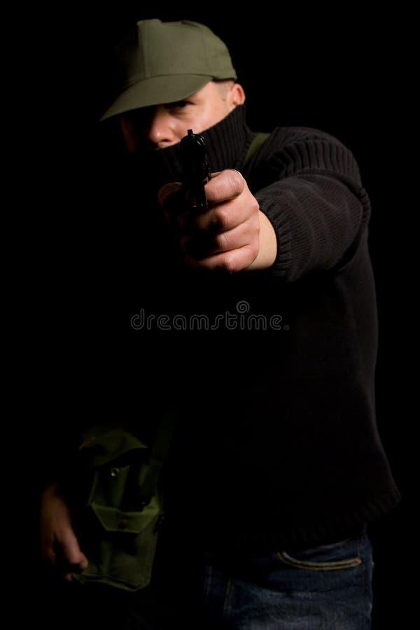 Verkleideter bewaffneter Bandit stockfotografie