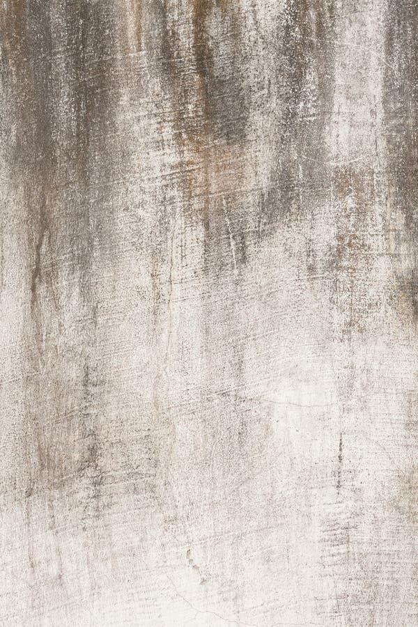 Verkratzte alte Betonmauerbeschaffenheit stockfoto