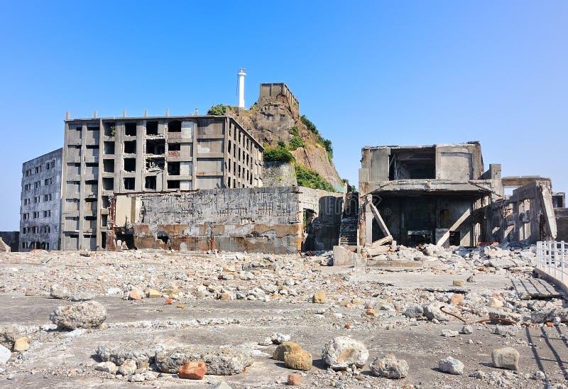 Verlaten gebouwen op Gunkajima in Japan stock foto's