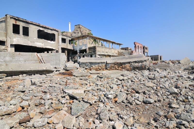 Verlaten gebouwen op Gunkajima in Japan stock afbeeldingen