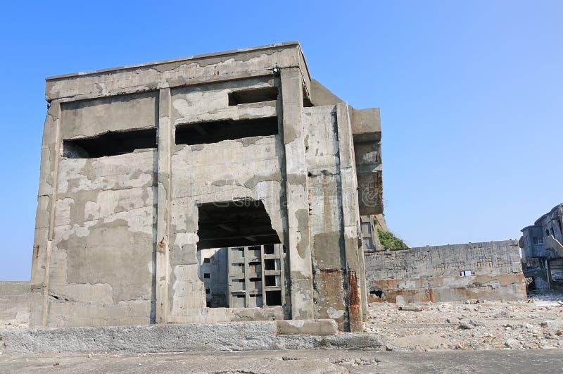Verlaten gebouwen op Gunkajima in Japan stock afbeelding