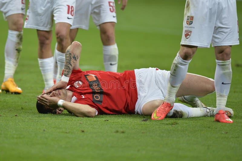 Verletzter Fußball- oder Fußballspieler lizenzfreies stockbild