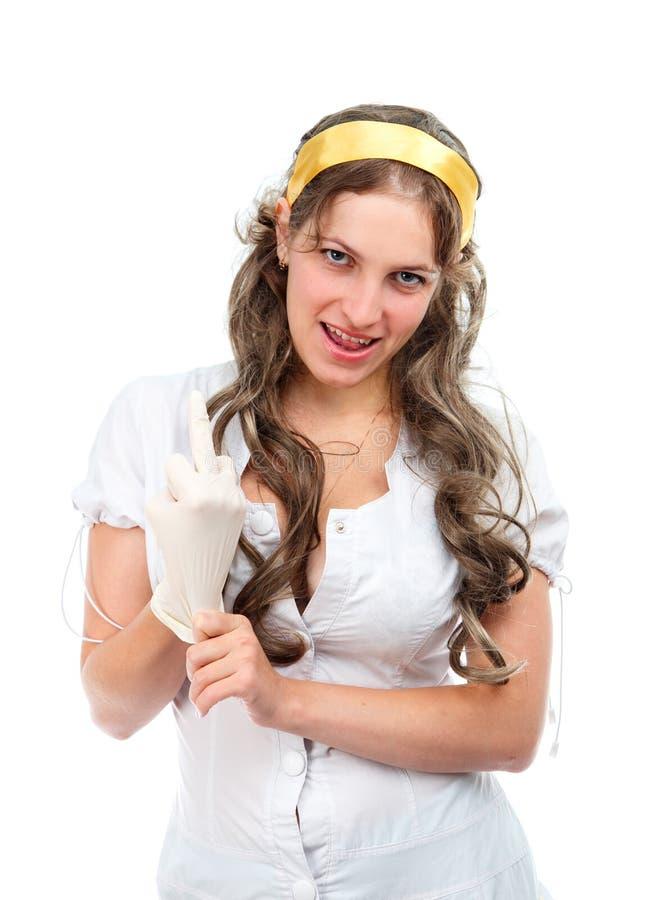 Verlockende Krankenschwester zeigt Mittelfinger stockbilder