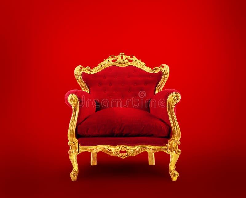 Vermelho e poltrona do luxo do ouro Conceito do sucesso imagem de stock