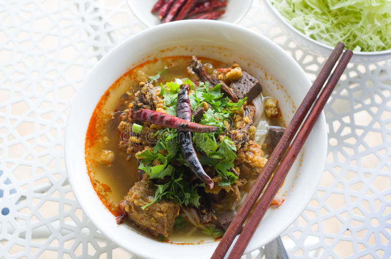 Vermicelli eaten with curry and Khao Soi Nam Ngeaw in Thai name. Traditional Northern Thailand Food White Noodles Spicy Soup in a Bowl, Khao Soi Nam Ngeaw royalty free stock image