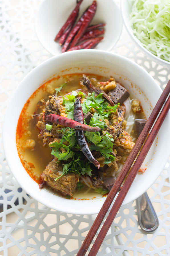 Vermicelli eaten with curry and Khao Soi Nam Ngeaw in Thai name. Traditional Northern Thailand Food White Noodles Spicy Soup in a Bowl, Khao Soi Nam Ngeaw stock image